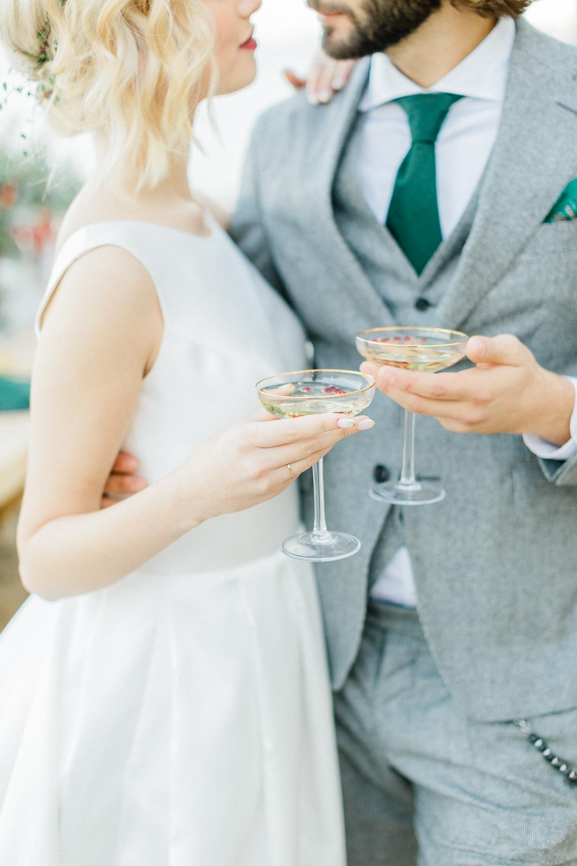 Elegant bride and groom make a toast on wedding day