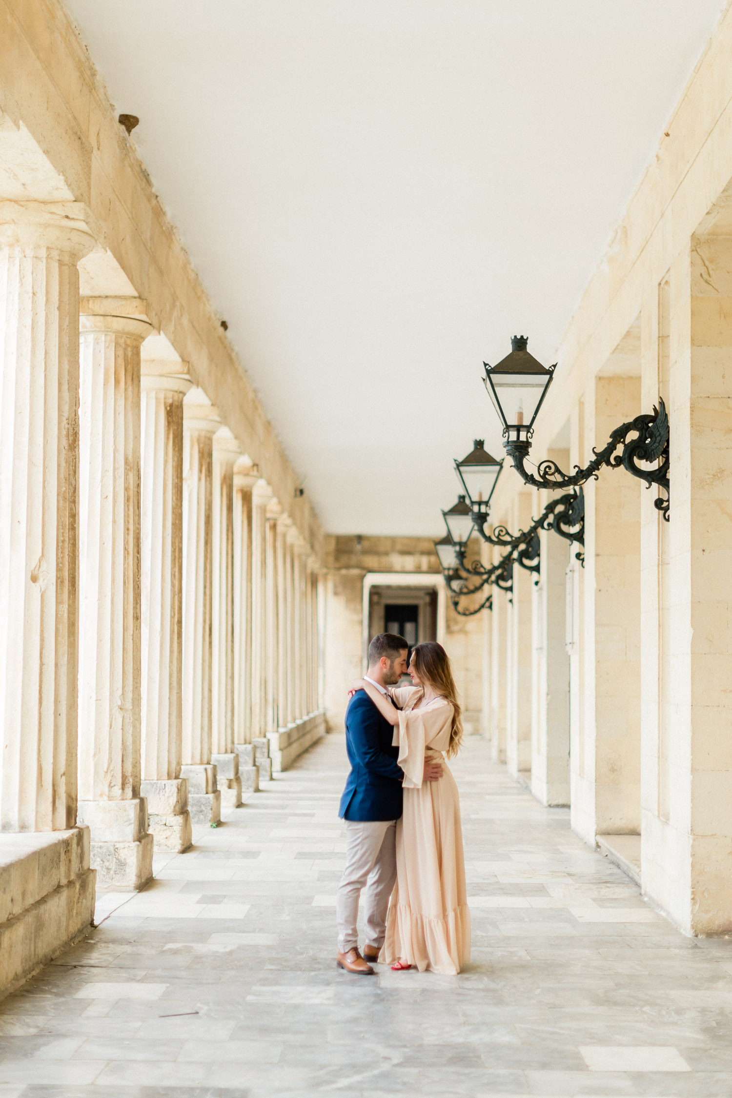 lovely meeting of a couple, while their engagement shooting at the Palace of St. Michael and St. George in Corfu.