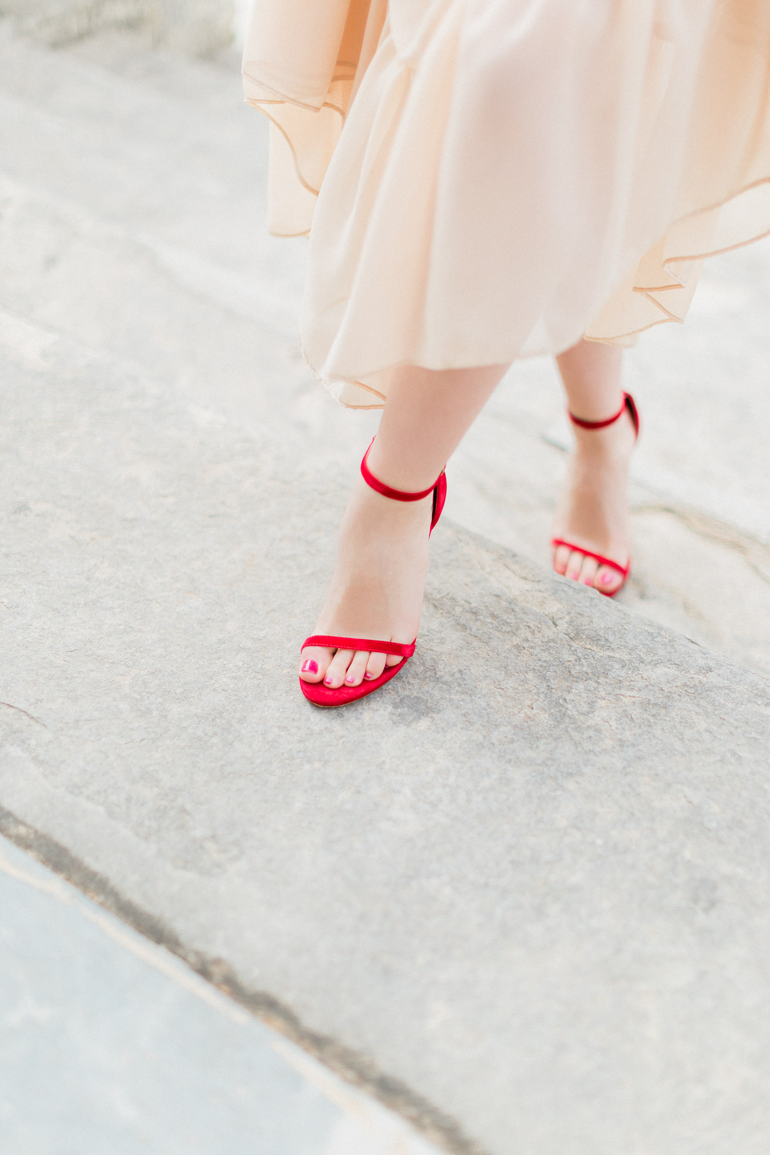 Steve Madden red high heels walk while an engagement shooting at Corfu island, Greece