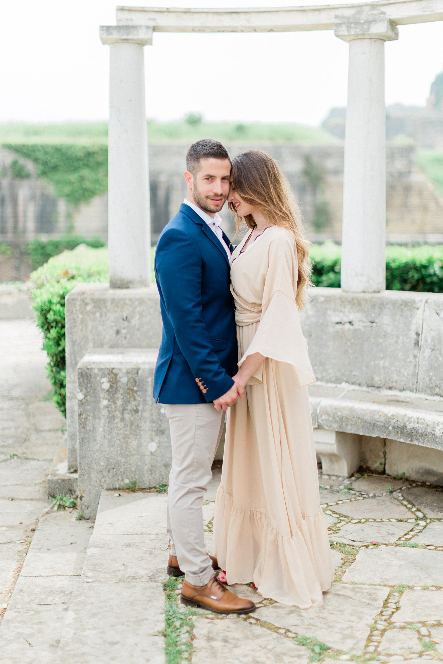 a warm hug of a couple while their engagement session at Corfu old town, Greece
