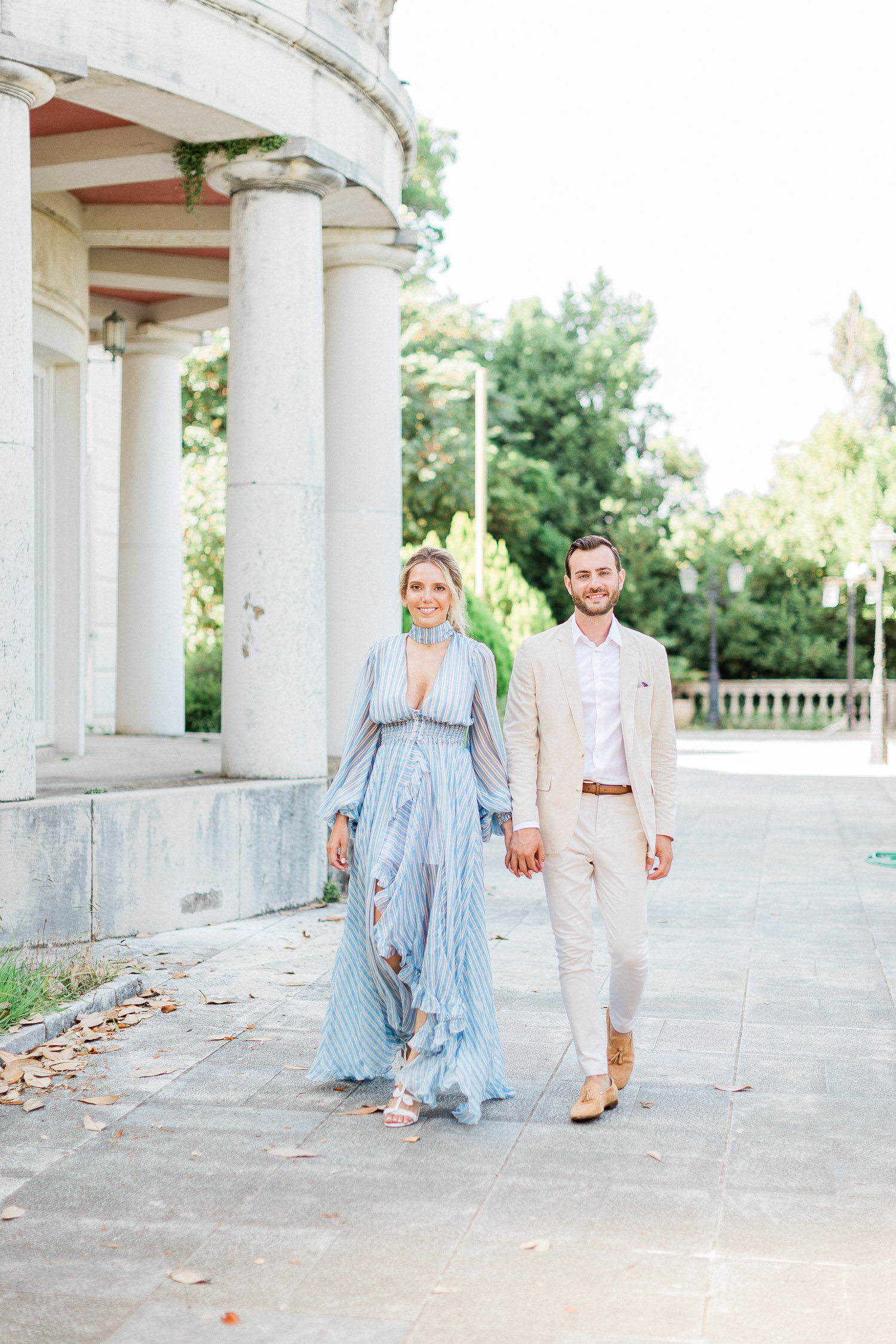 a wonderful couple walking down the mon repos palace, Corfu island