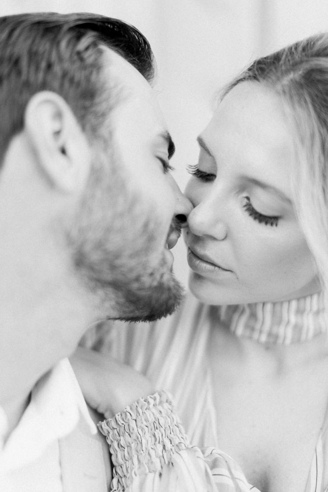 Young and beautiful couple celebrate their love while kissing each other
