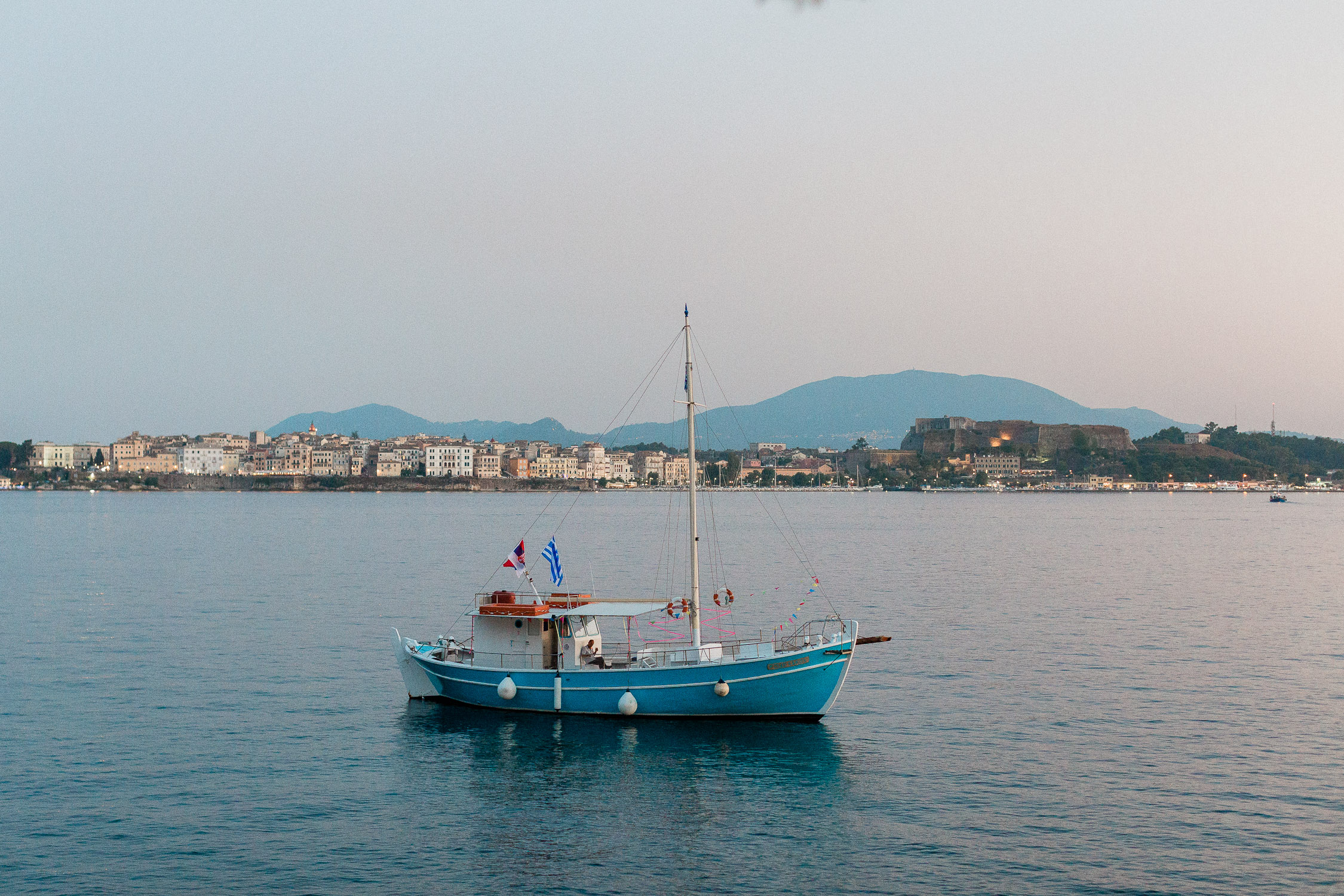 bespoke view of Corfu island while sun goes down