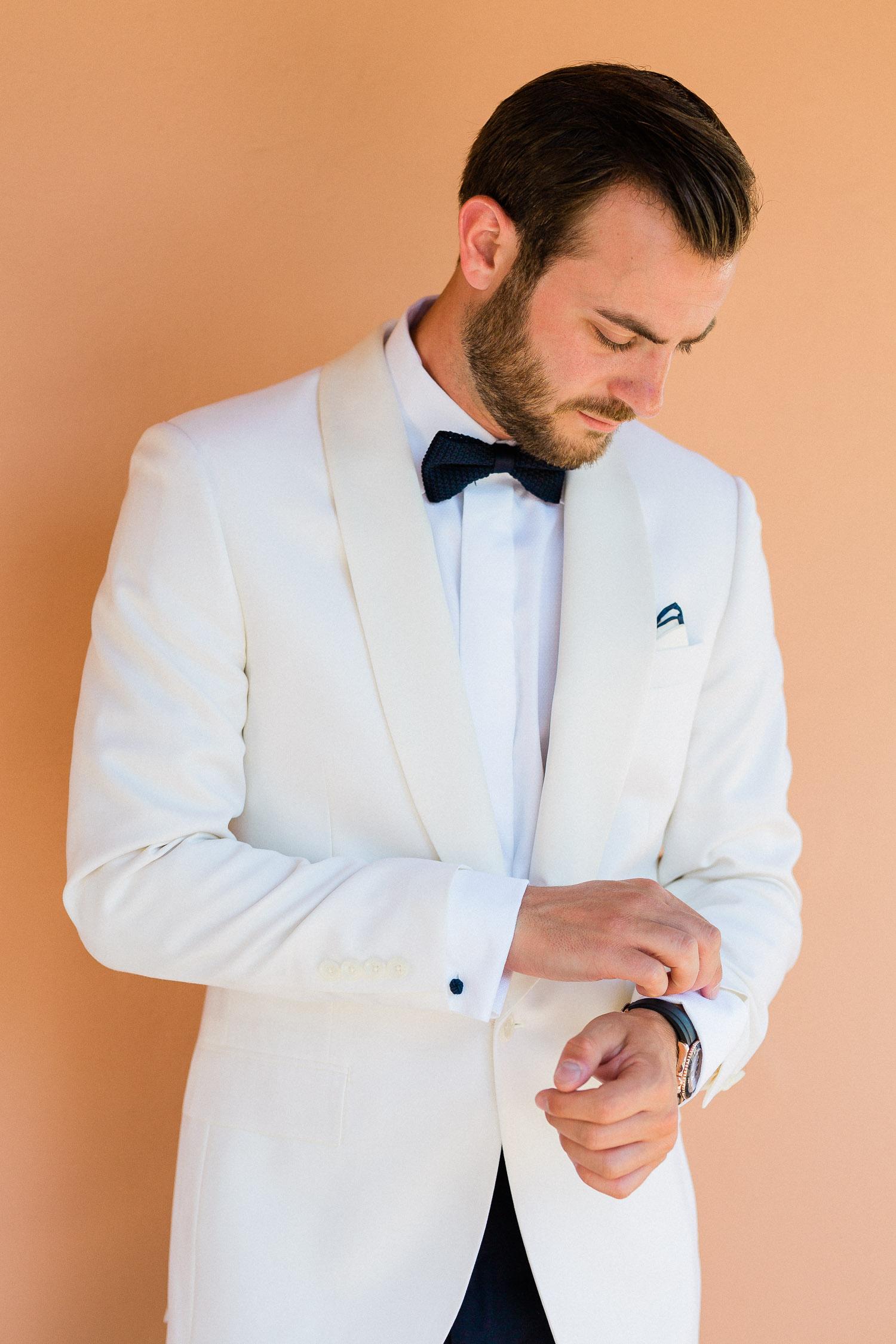 groom is getting ready on a July wedding in Corfu