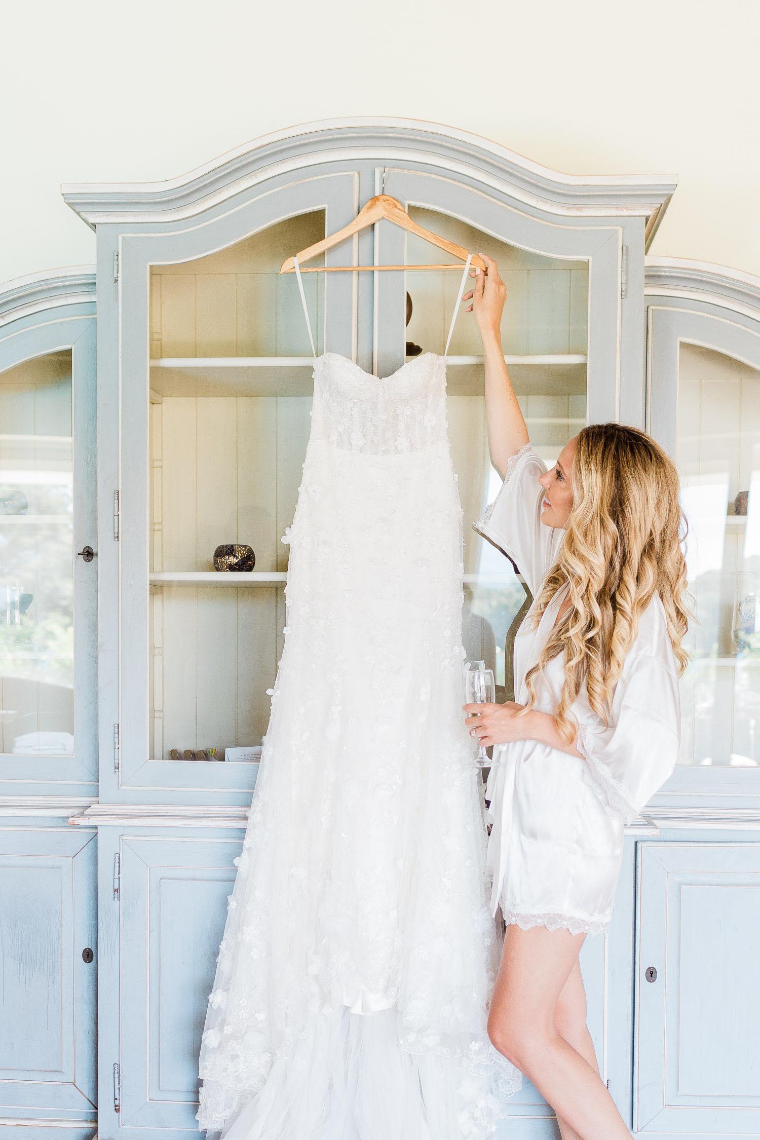 stunning bride loves her romantic wedding dress on a July wedding in Corfu