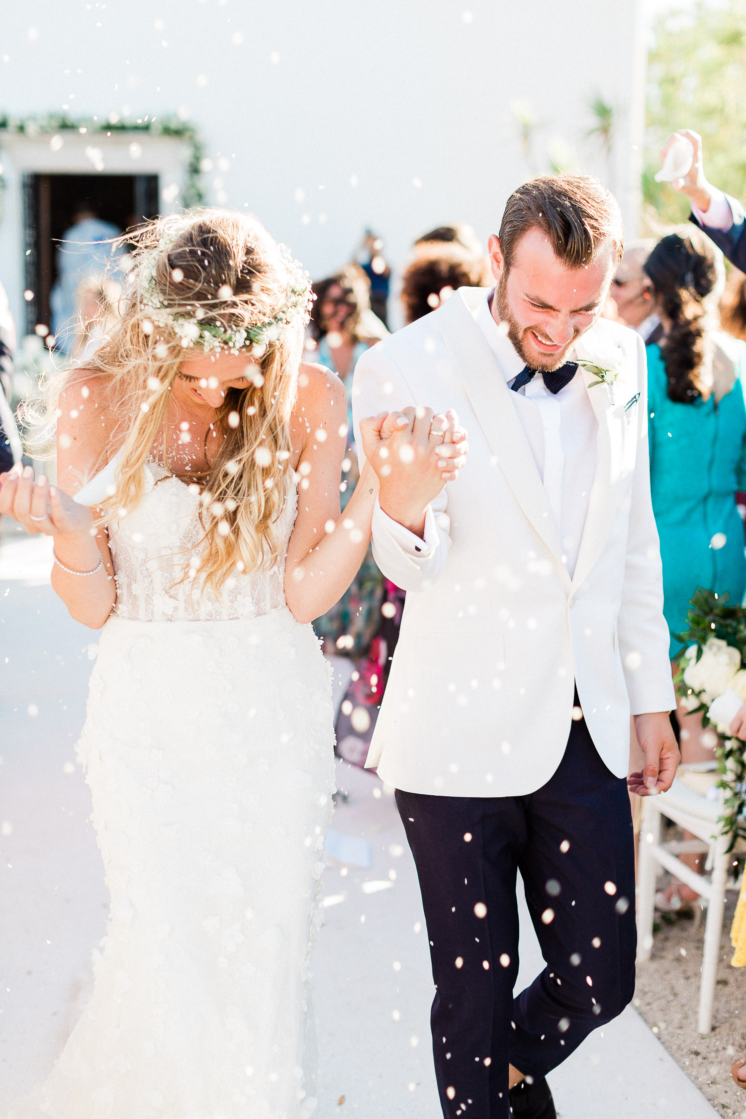 couple exit from ceremony on a corfu wedding