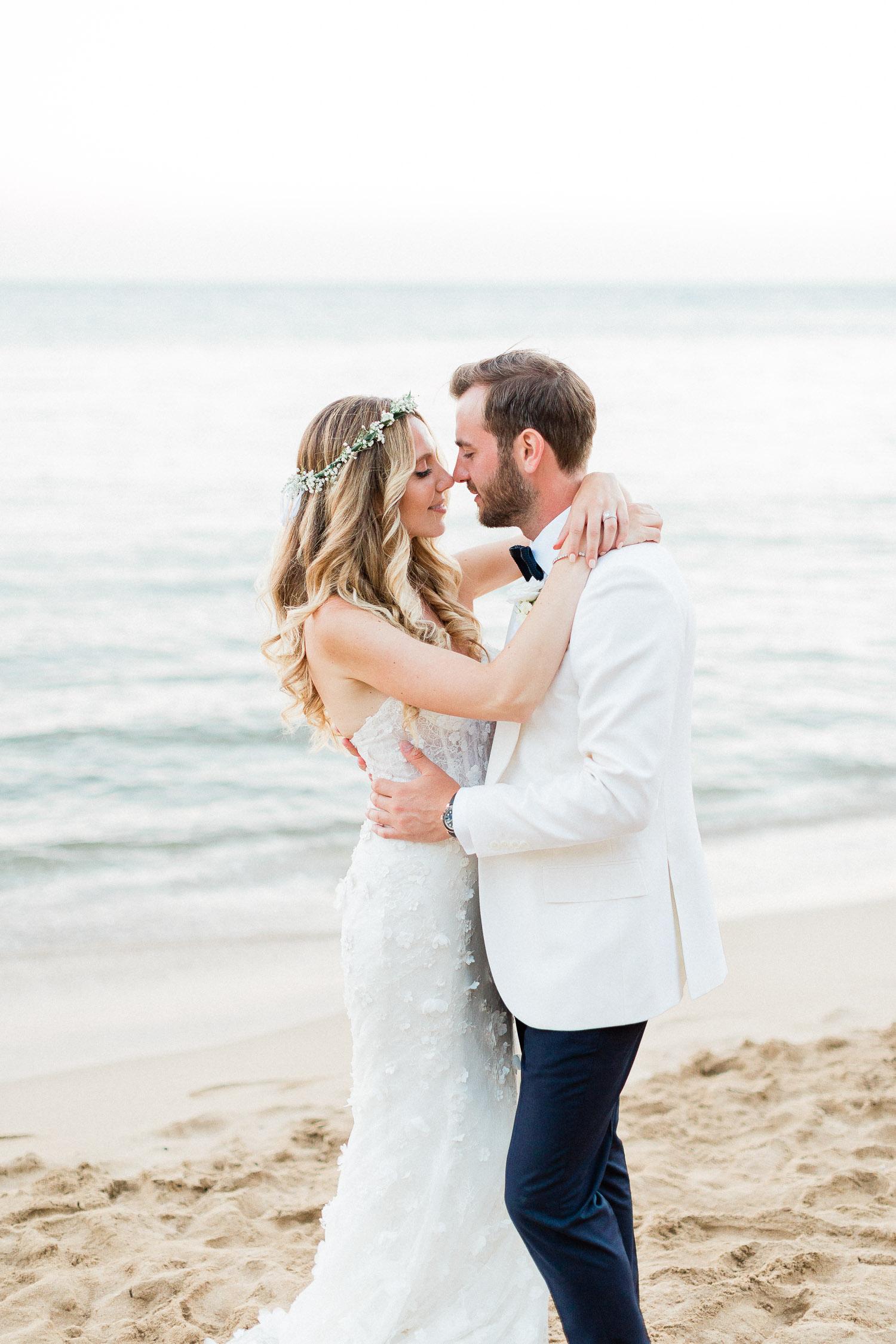 sweet moment of newlyweds on Corfu beach