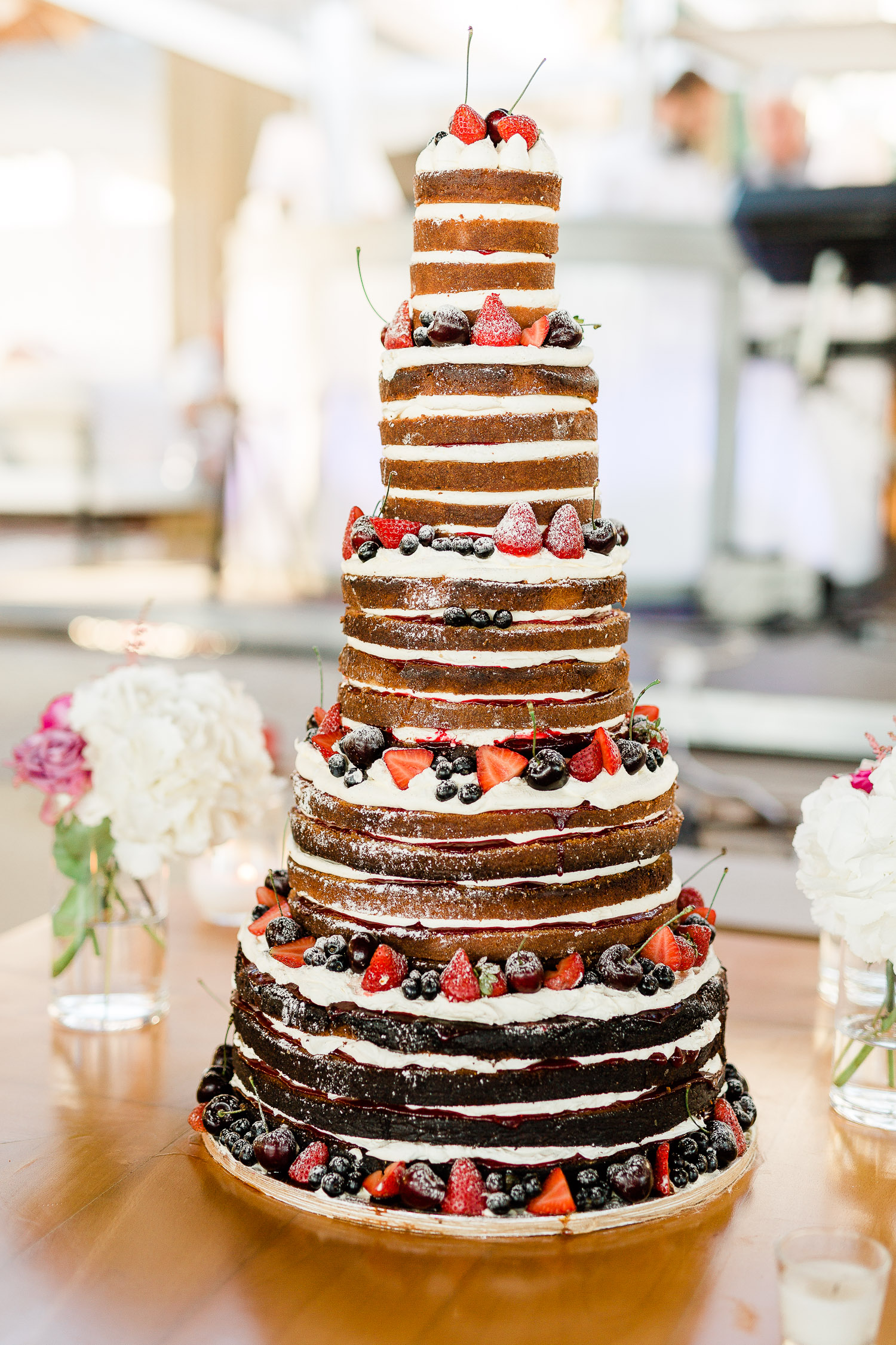 wedding naked cake with strawberries, cherries and blueberries
