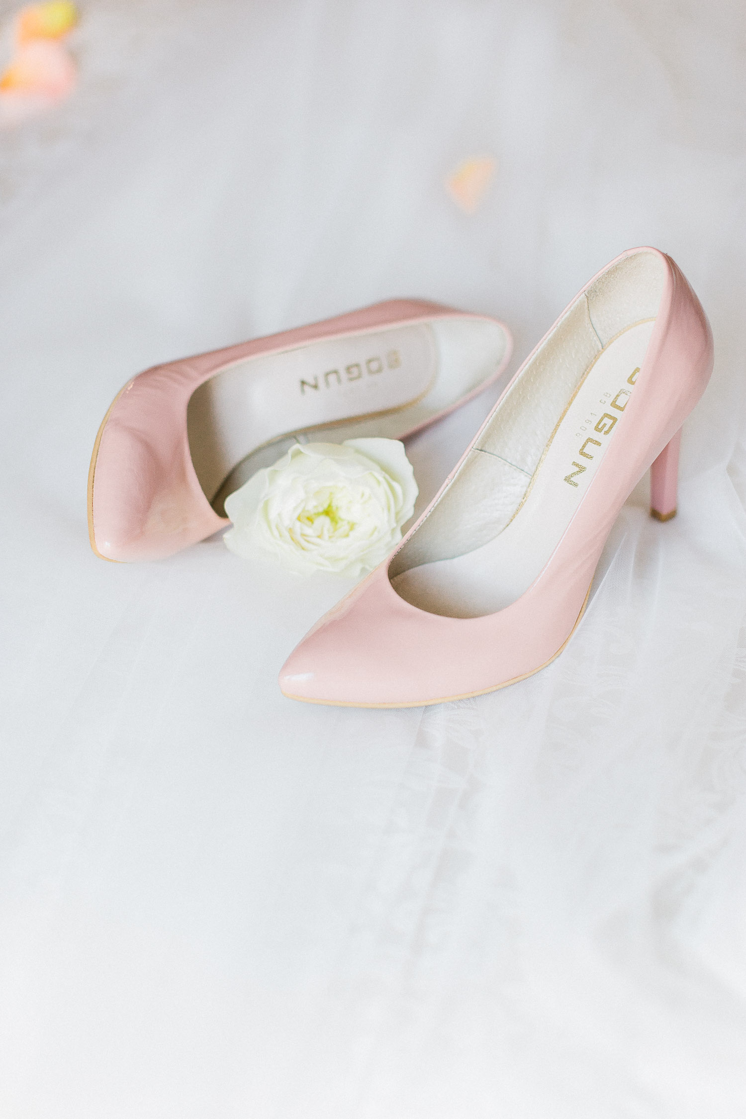 dusty pink bridal shoes still life