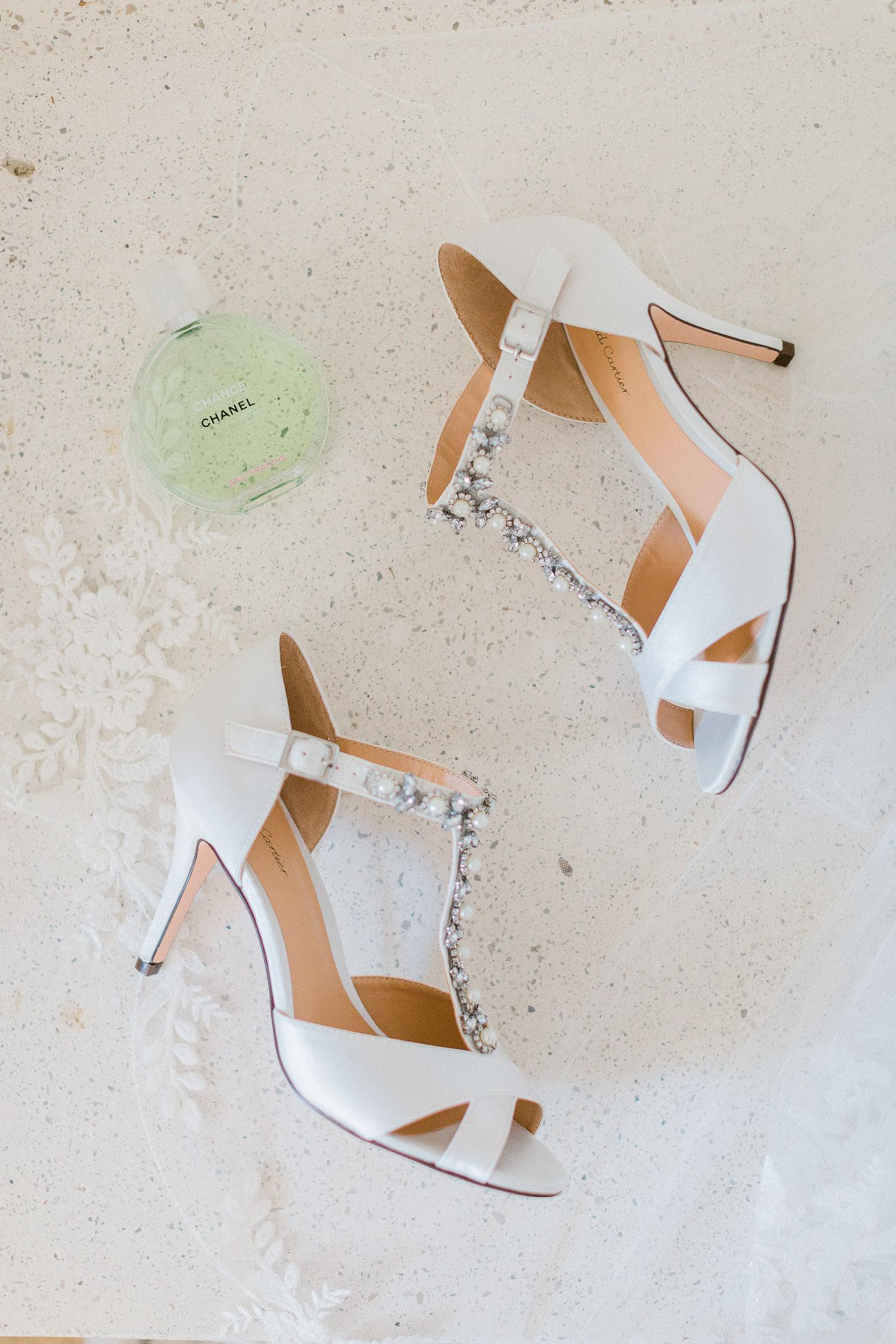 bridal shoes flat lay on Traditional corfu estate wedding