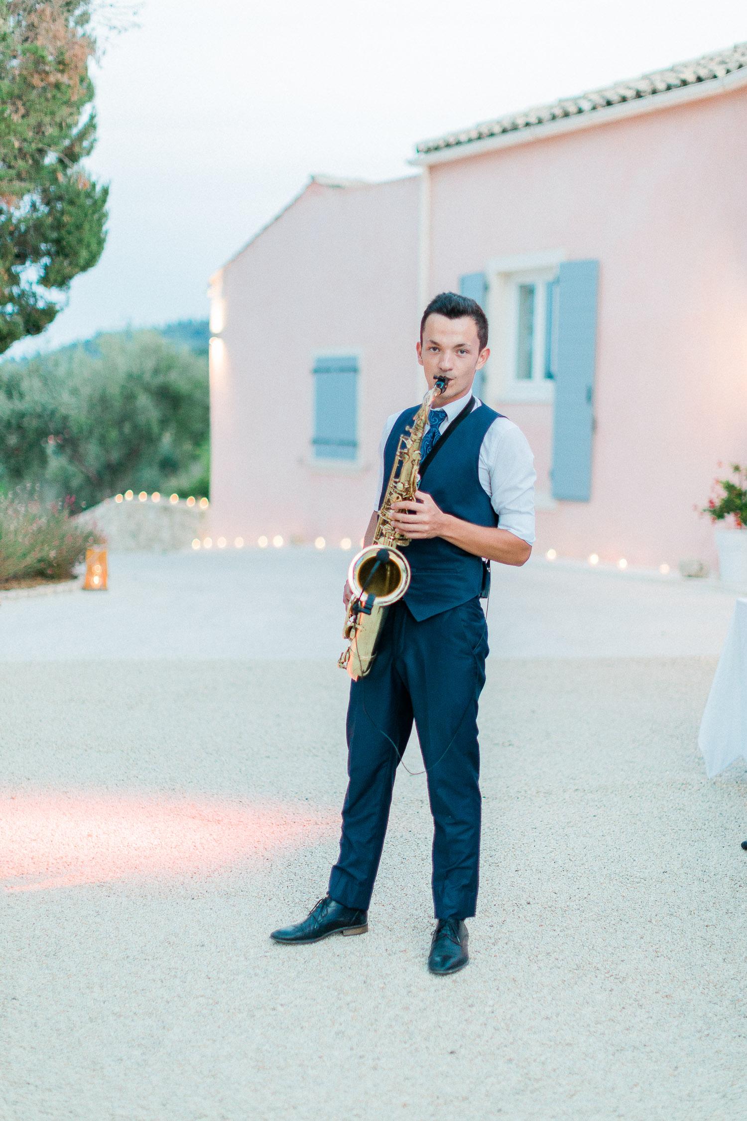 saxo player on this Traditional corfu estate wedding