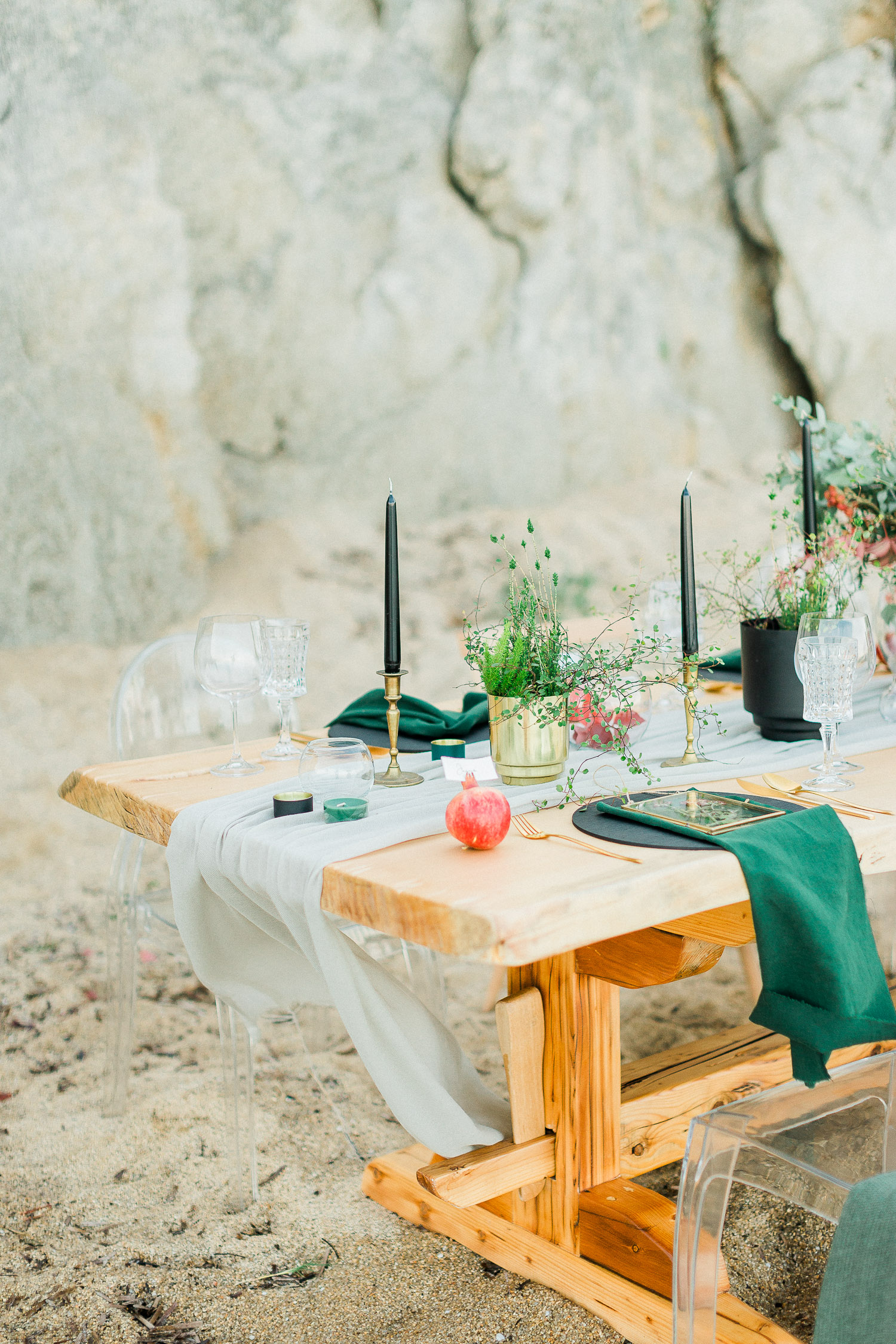 table set up on a rocky beach in Halkidiki, Greece