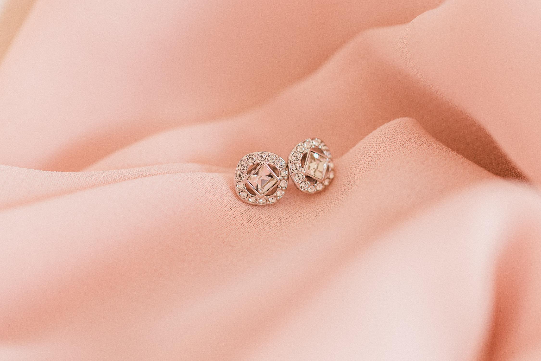 diamond earrings details on a silk textile