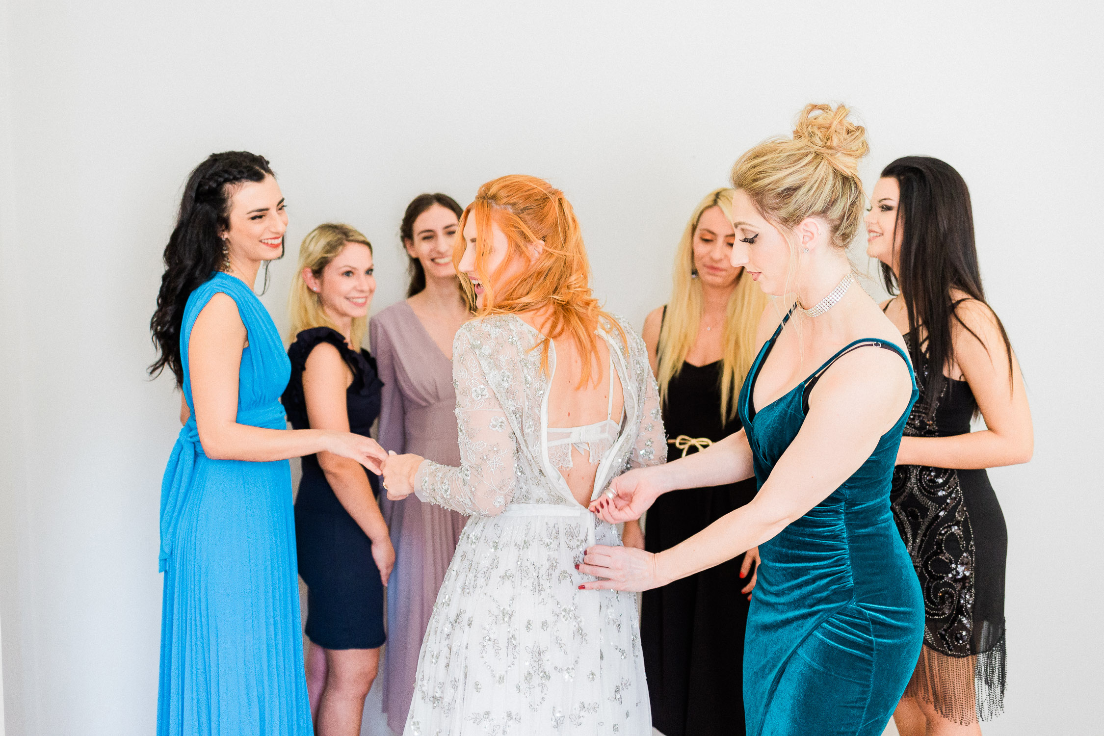 bride and bridesmaids while her wedding preparation