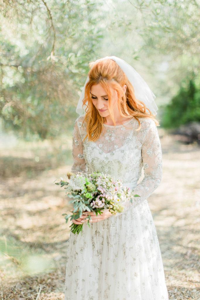 a luminous fine art portrait of a bride holding her wedding bouquet