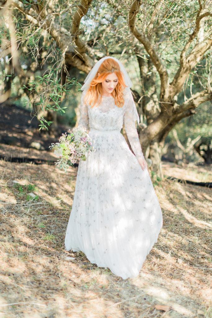 beautiful bridal portrait at Greek landscape full of olive trees