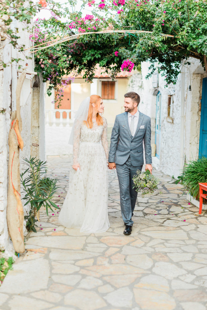 bride & groom walking on a traditional route at Corfu island