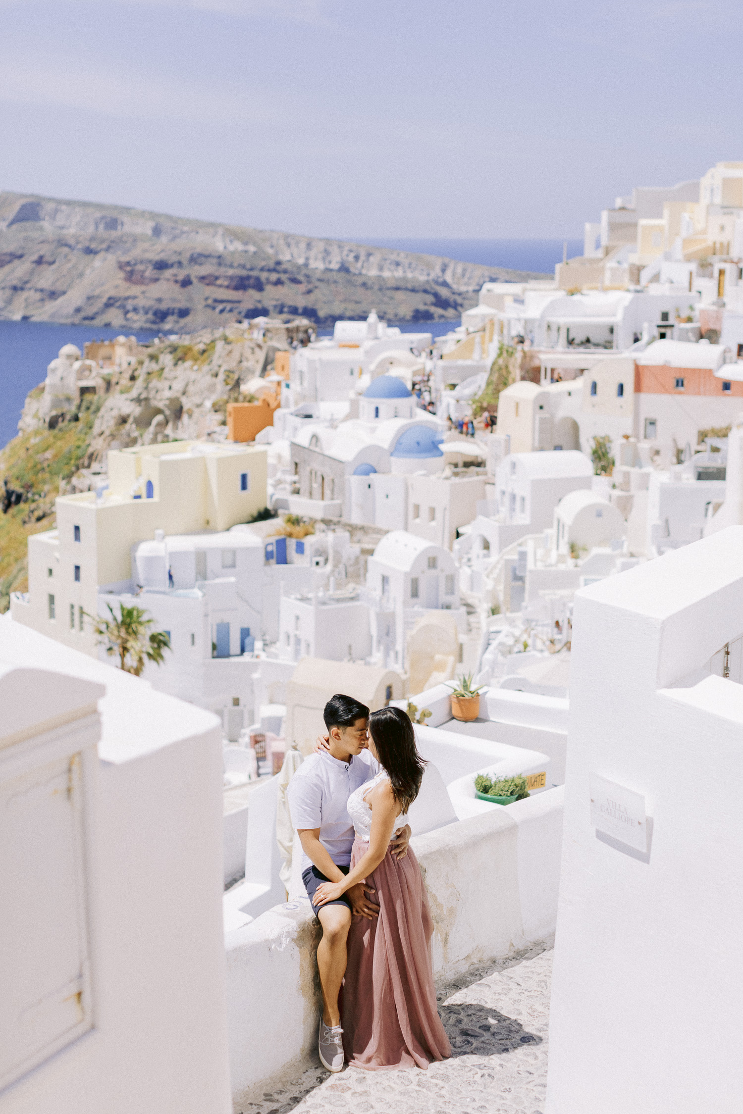 Strolling around Santorini and capture this amazing couple's engagement shoot