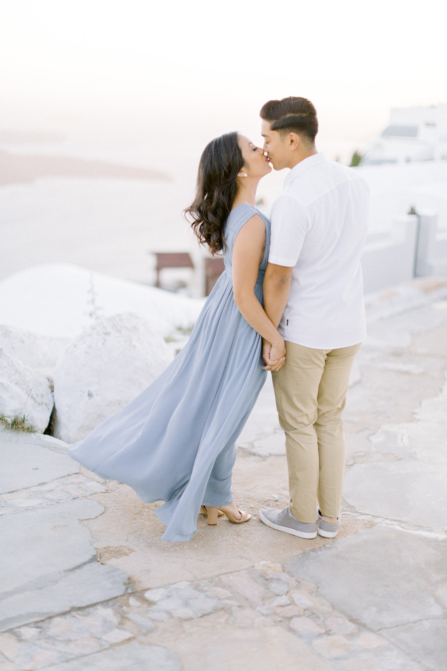 Bride & groom to be looks stylish on white and blue outfit in Santorini
