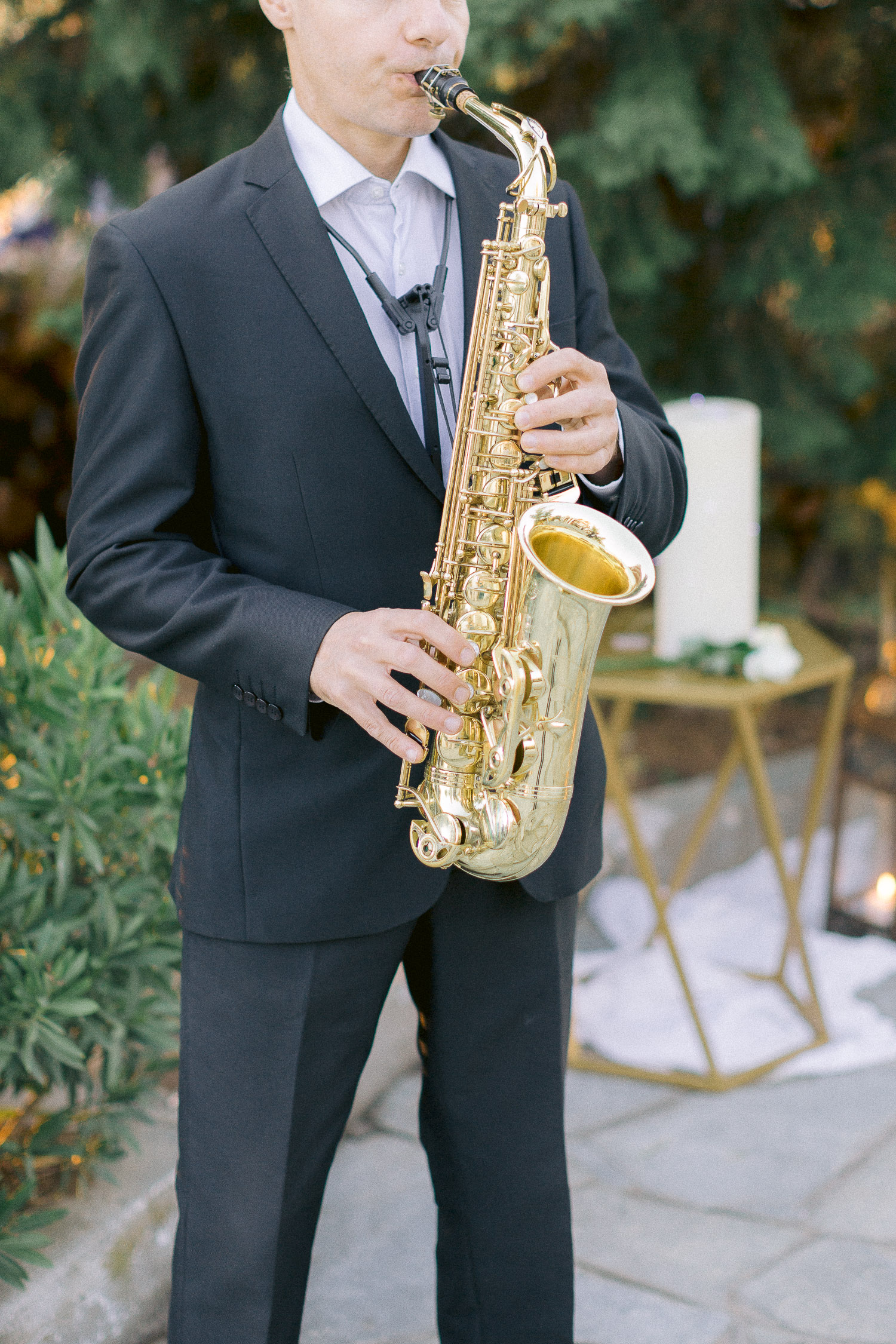 Romantic coastal wedding sax player welcome wedding guests