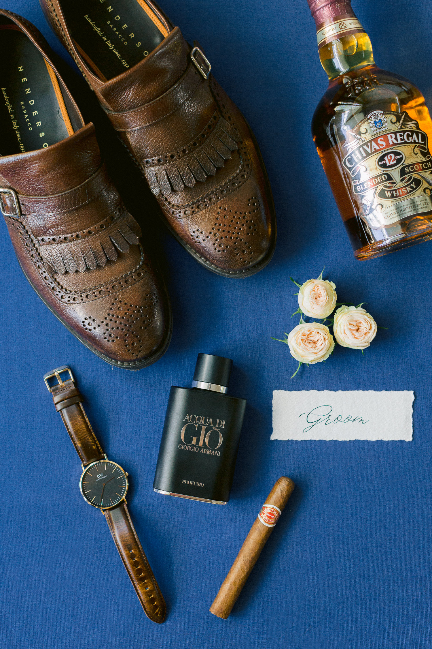 Groom's classy styling details on brown palette