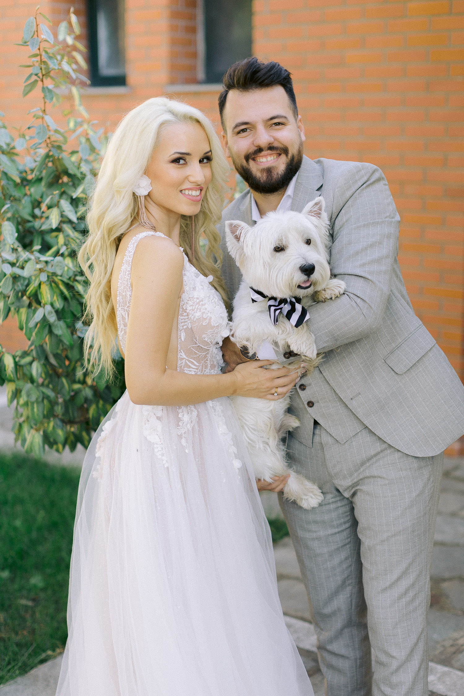 Romantic coastal wedding Bride and groom portrait with their beloved dog