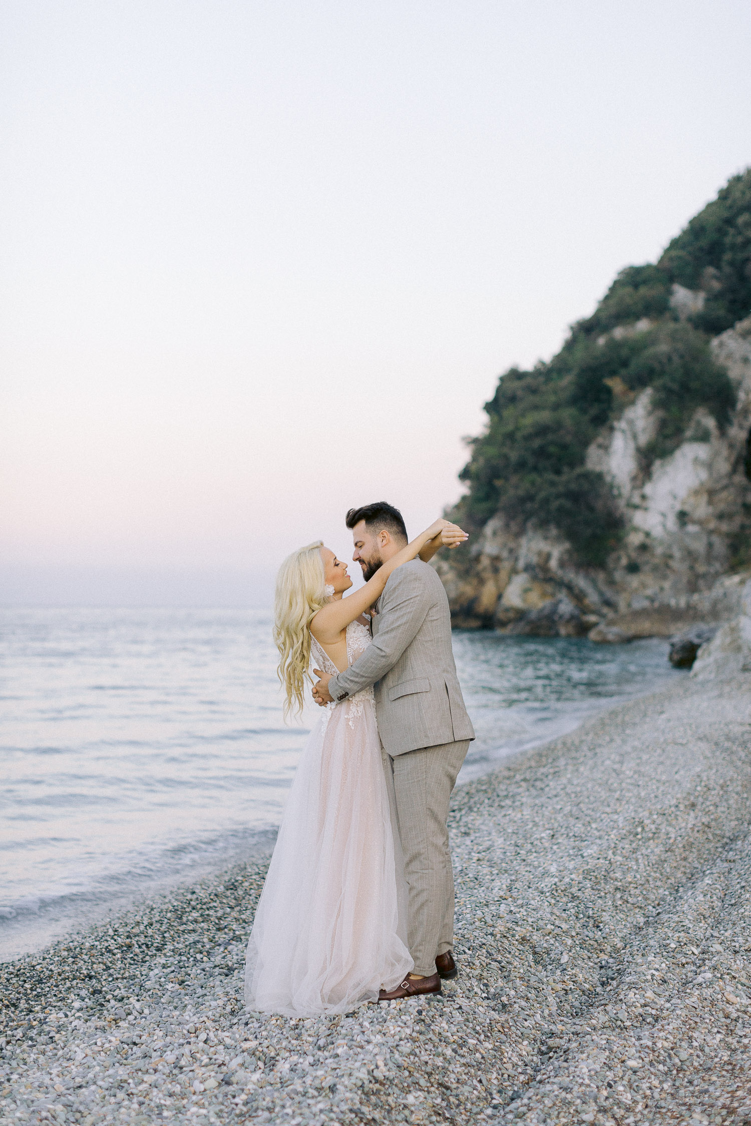romantic coastal wedding in Greece bride and groom sweet moment