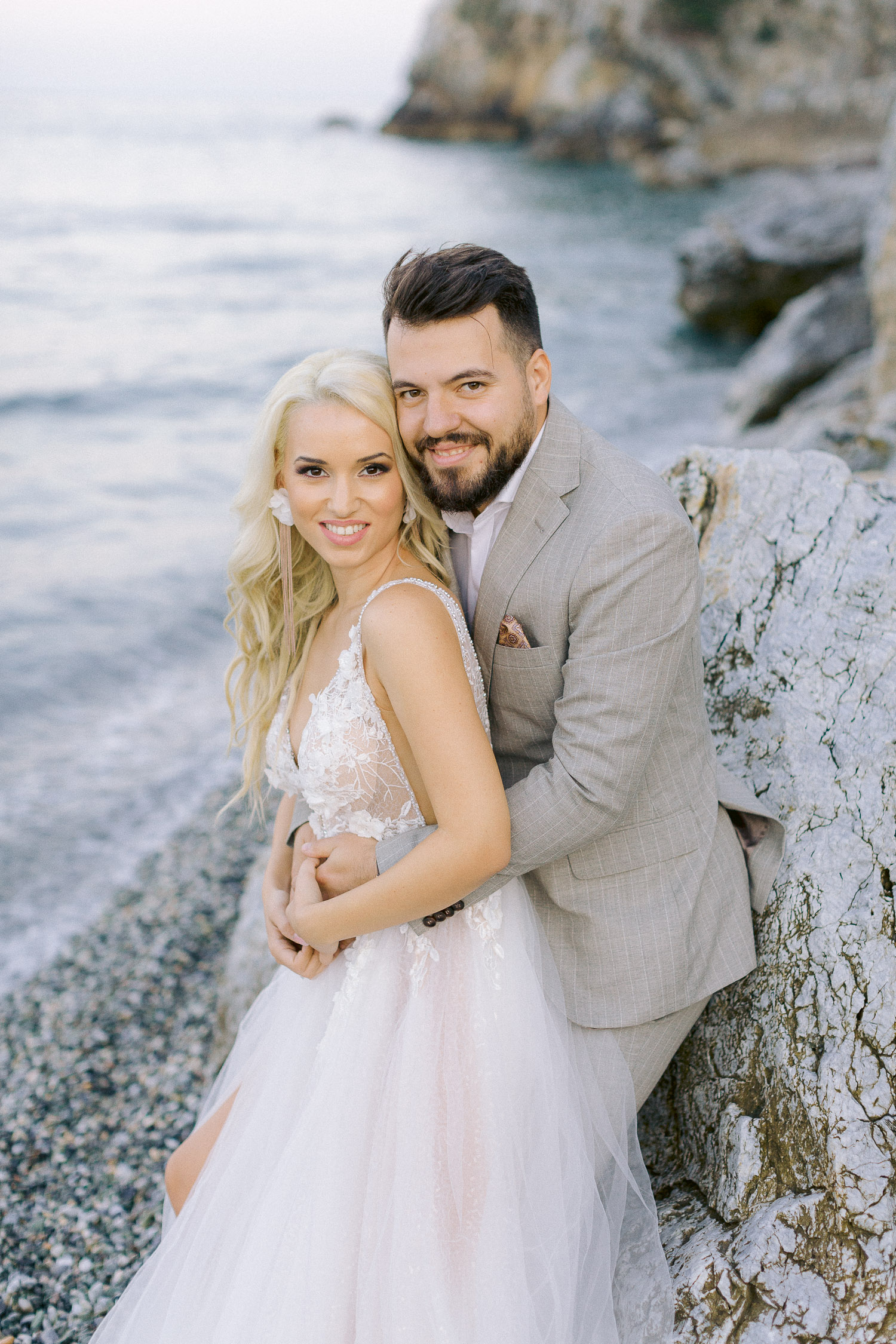 romantic coastal wedding in Greece bride and groom portrait on the beach