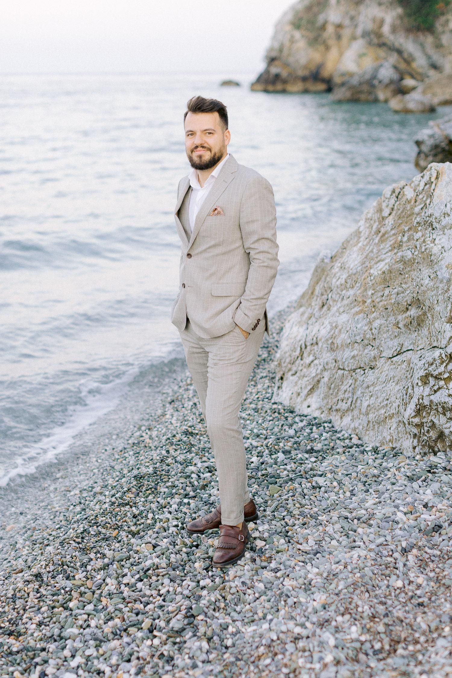 romantic coastal wedding in Greece fashion groom portrait