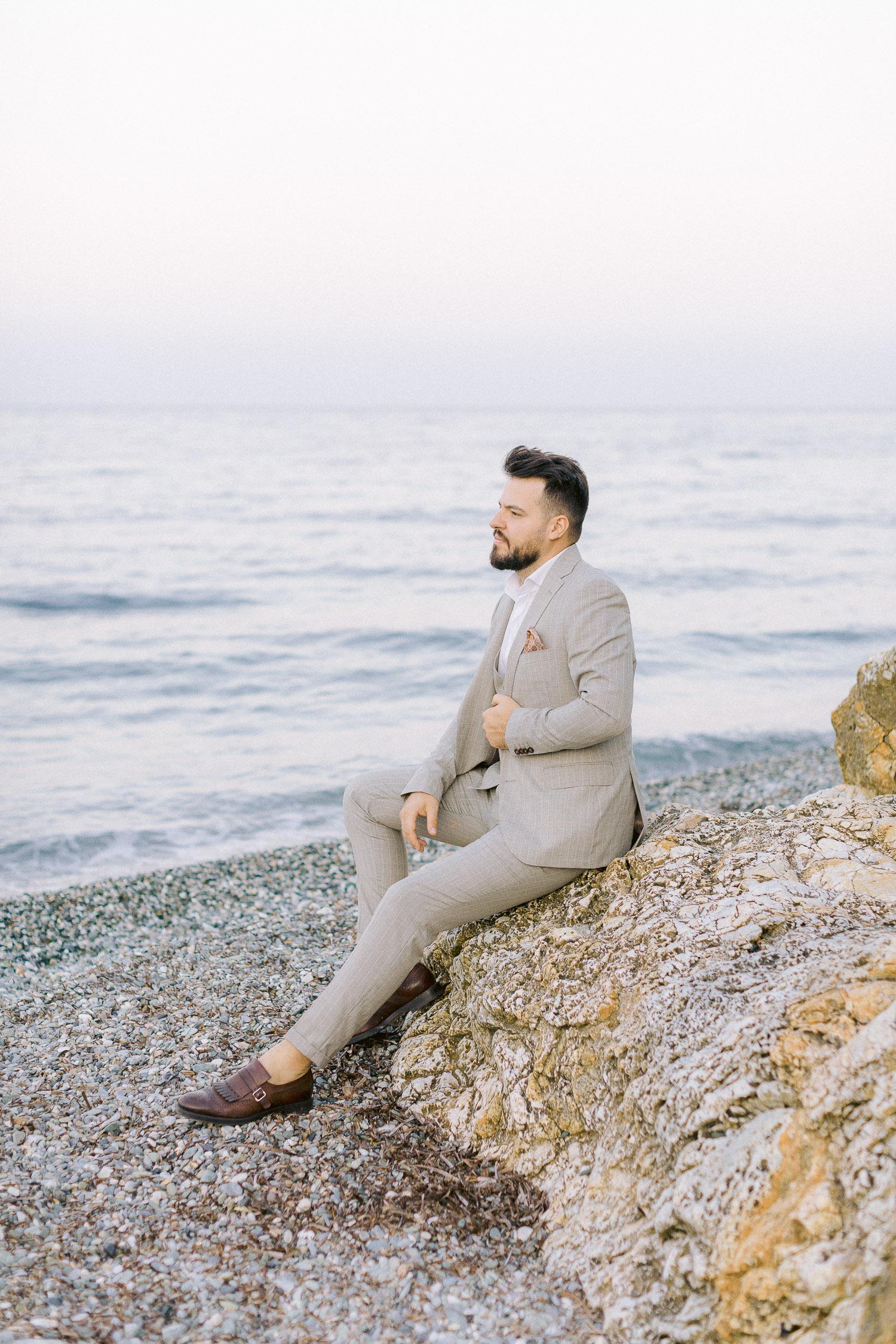 romantic coastal wedding groom on a grey suit