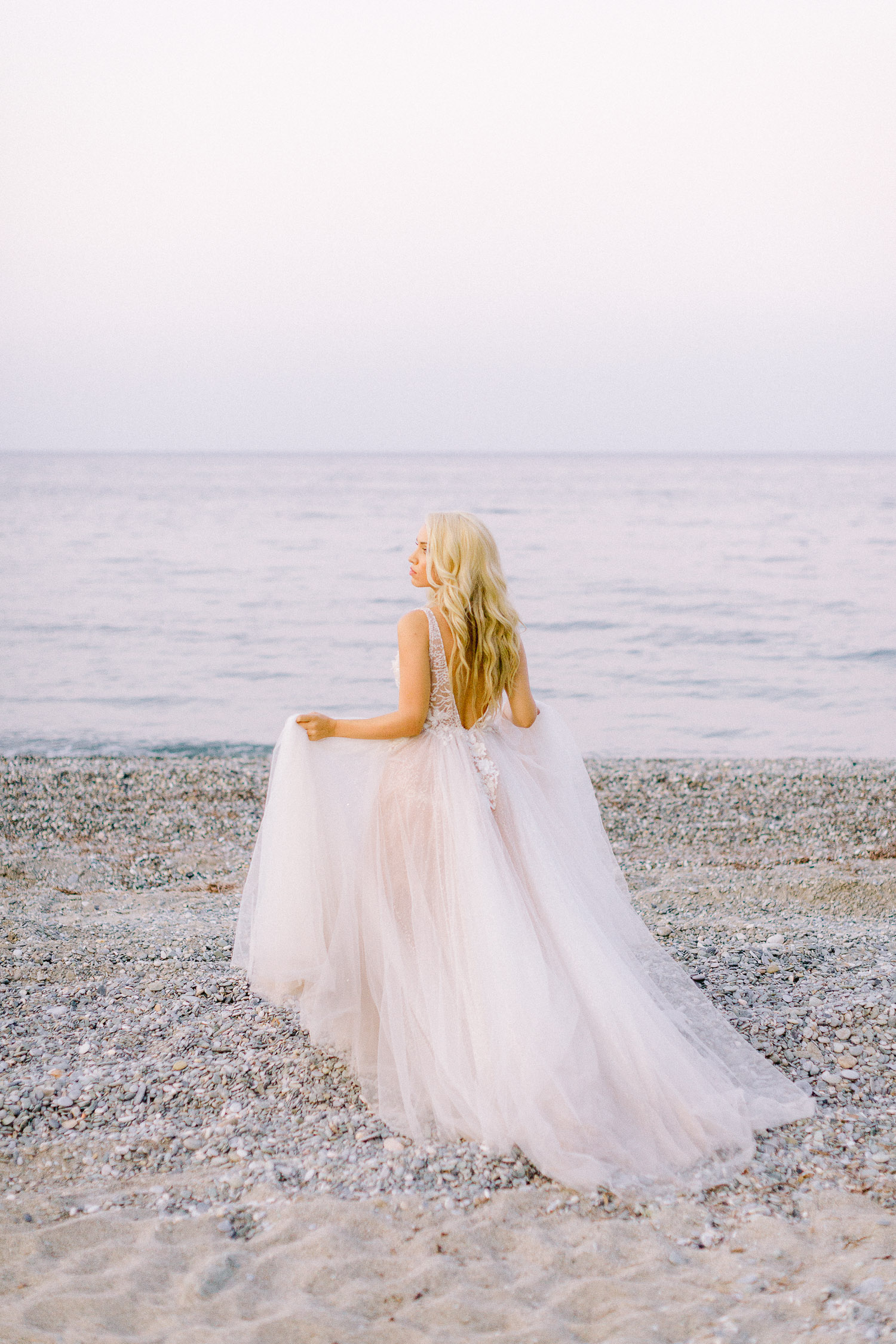 romantic coastal wedding gorgeous blonde bride wearing a romantic lace wedding gown