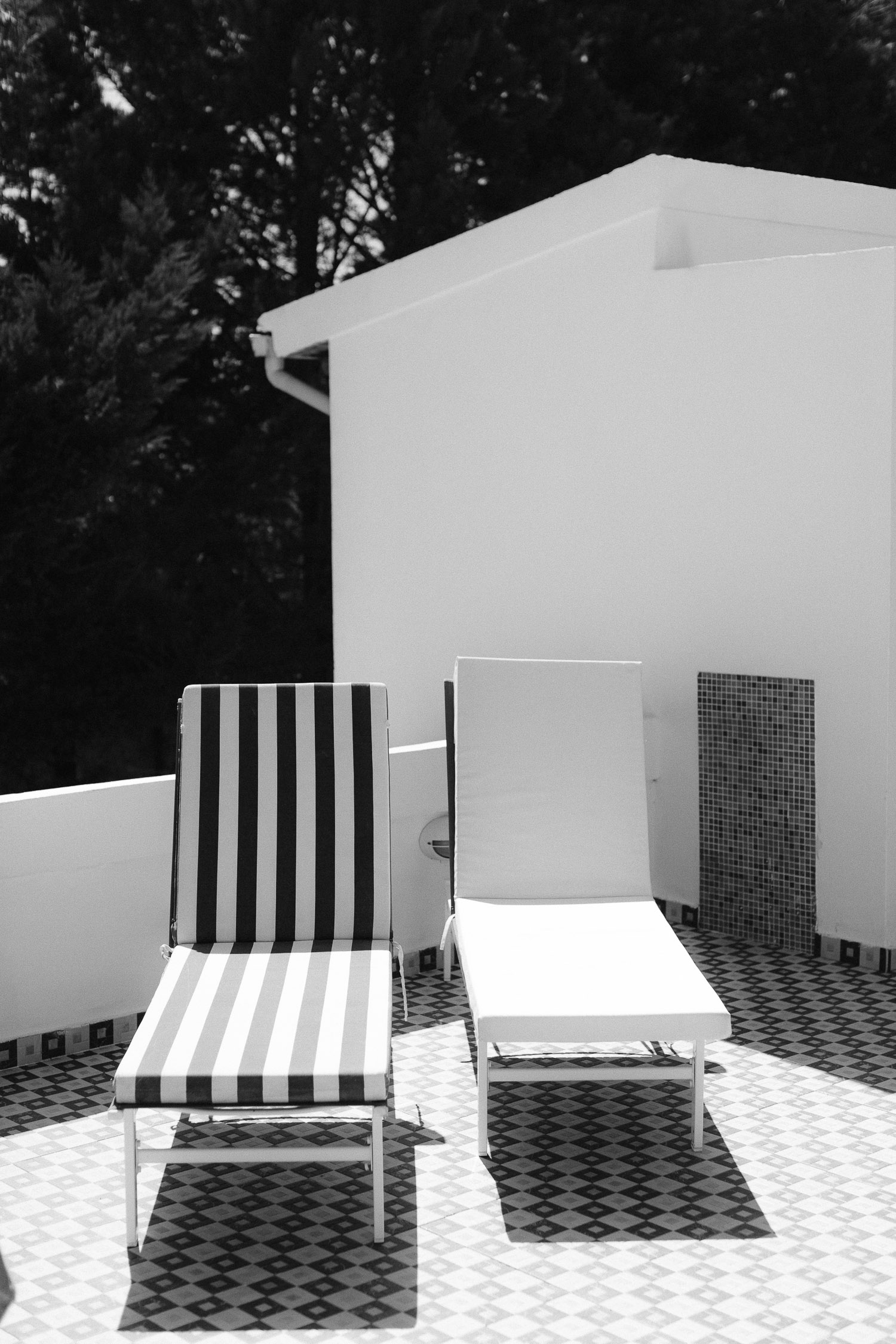 Black and white sunbeds at a luxury villa at Corfu