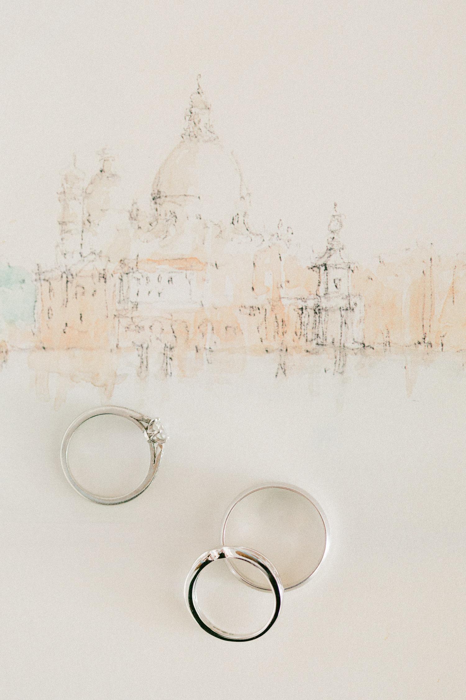 Bridal round halo engagement ring and minimal wedding rings artwork flat-lay