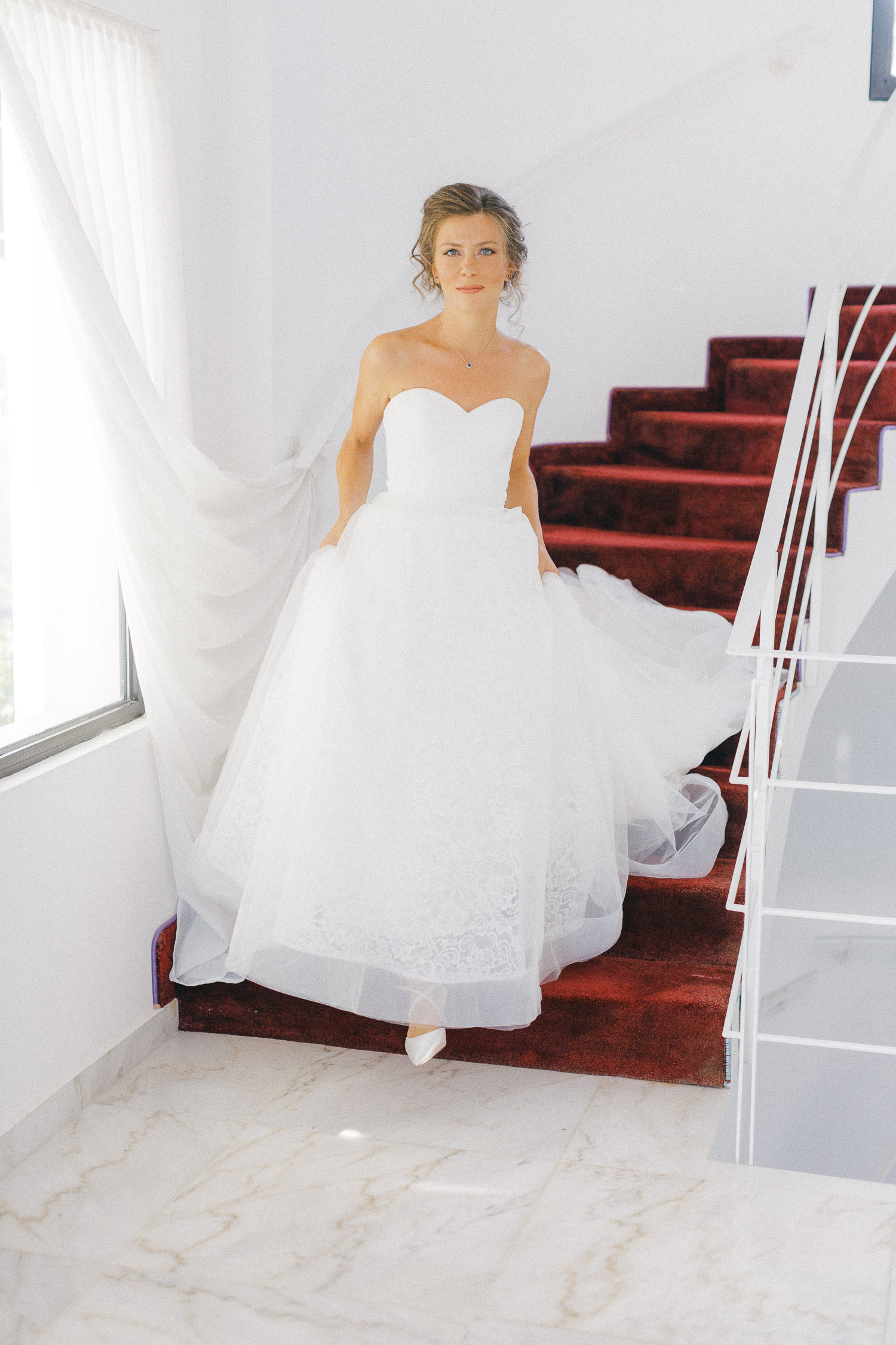 Bride going down the wedding venue stairs at Old World micro wedding in Corfu Island