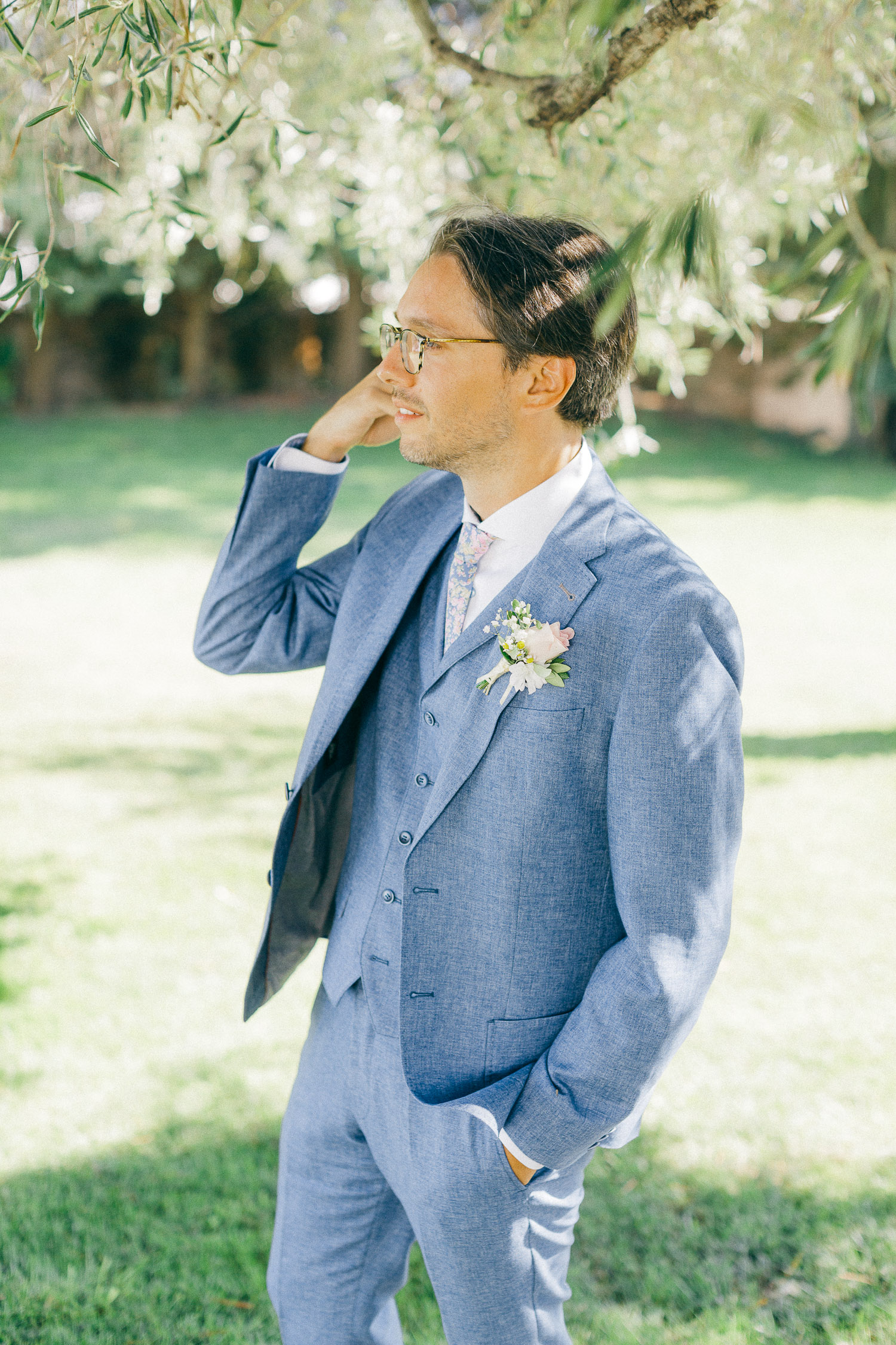 Groom's portrait wearing a baby blue attire at Old World micro wedding in Corfu