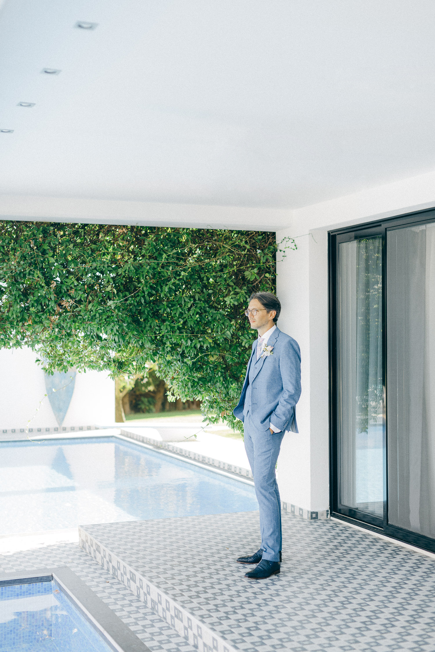 Groom enjoying the poolside at Old World micro wedding in Corfu