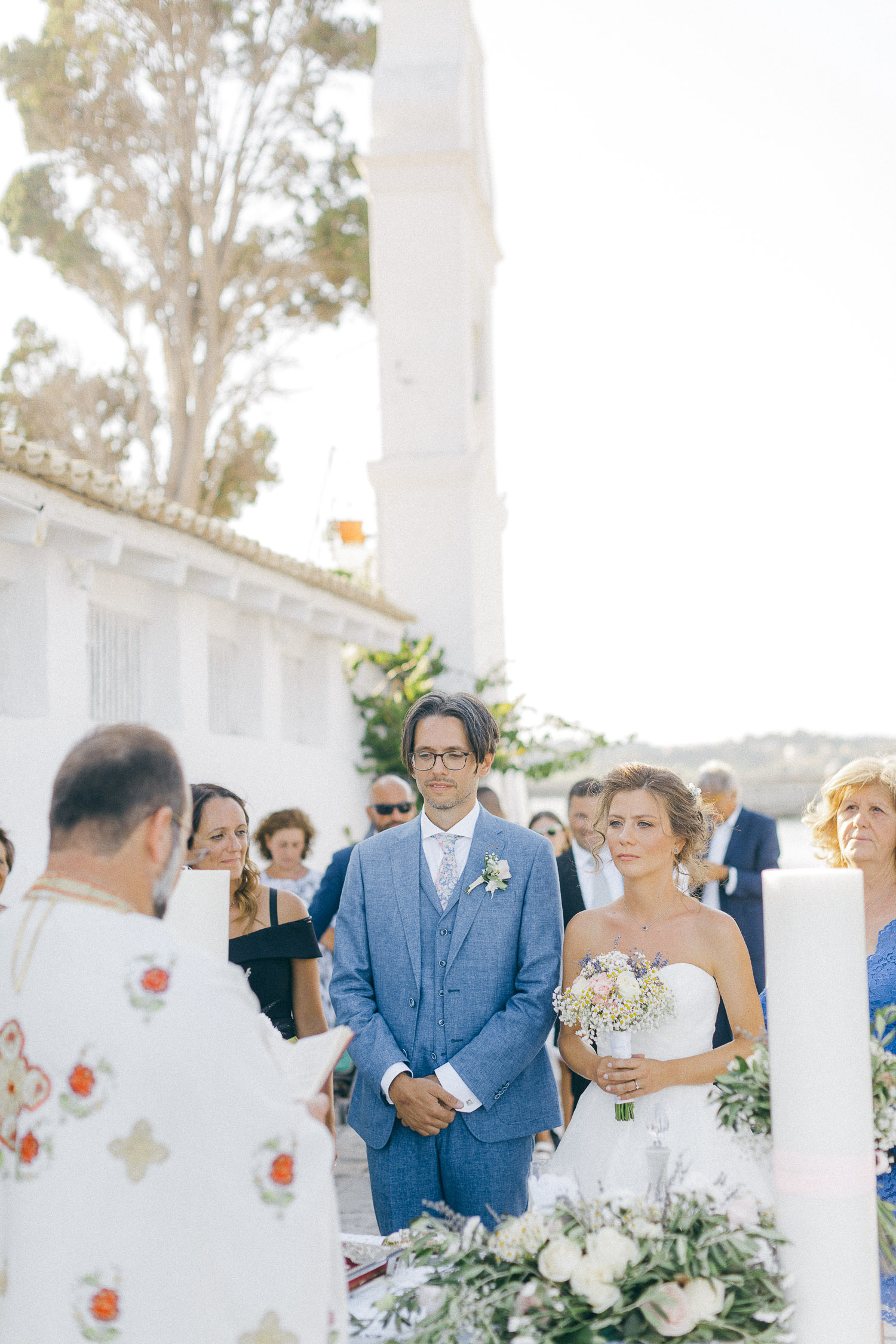 Bride and groom on the wedding ceremony while an Old World micro wedding in Corfu Island