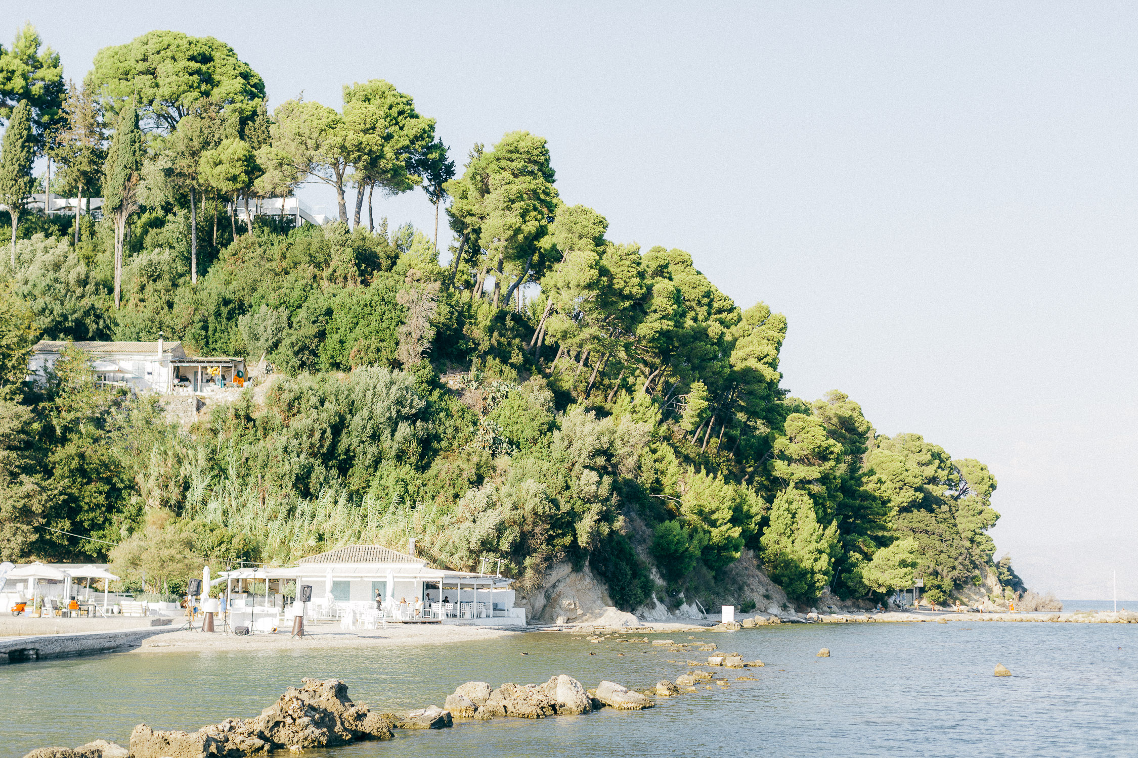 Wooded peninsula full of green in Corfu Island above a wonderful Corfu venue