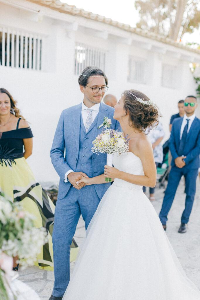 Touching newlyweds moments while an Old World micro wedding in Corfu Island