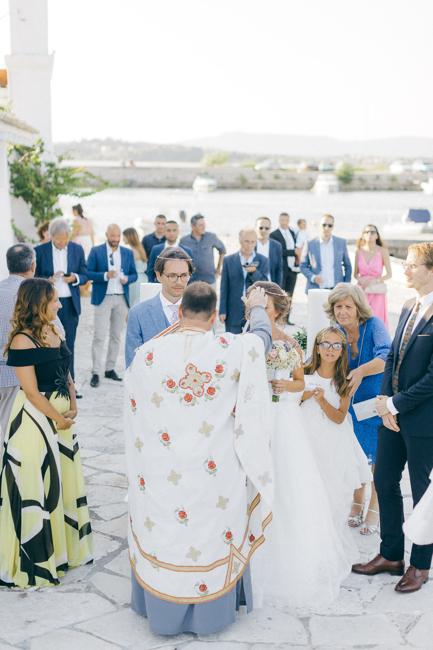 Bride and groom while on wedding ceremony while an Old World micro wedding in Corfu Island