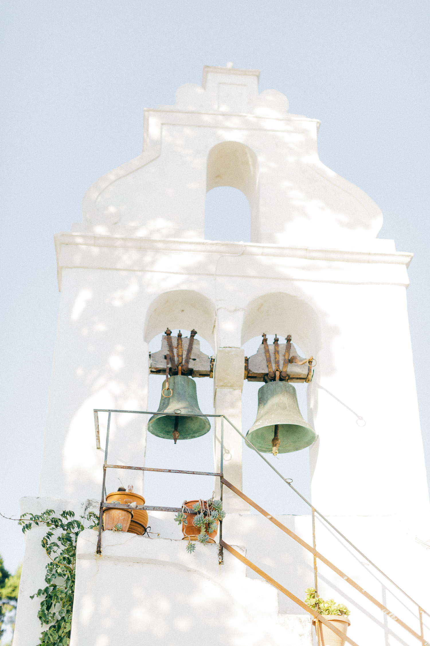 All white minimal bell tower in Corfu island on wedding day