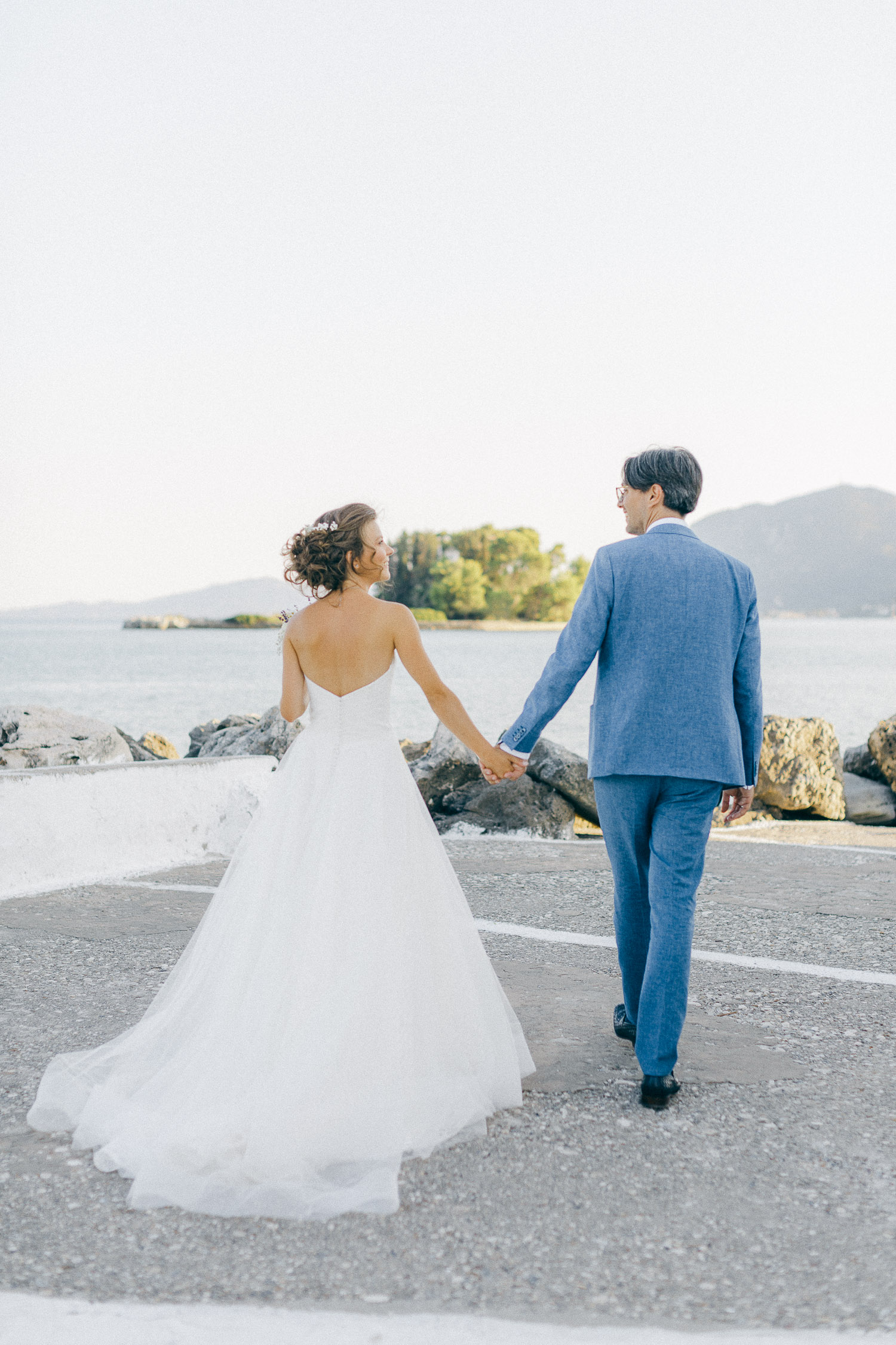 After ceremony couple shooting next to the water while an Old World micro wedding in Corfu Island