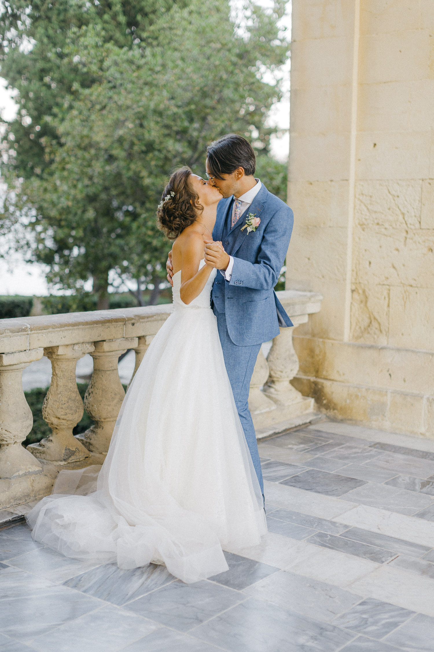 Bride and groom first dance in front of Corfu palace whine Old World micro wedding in Corfu Island