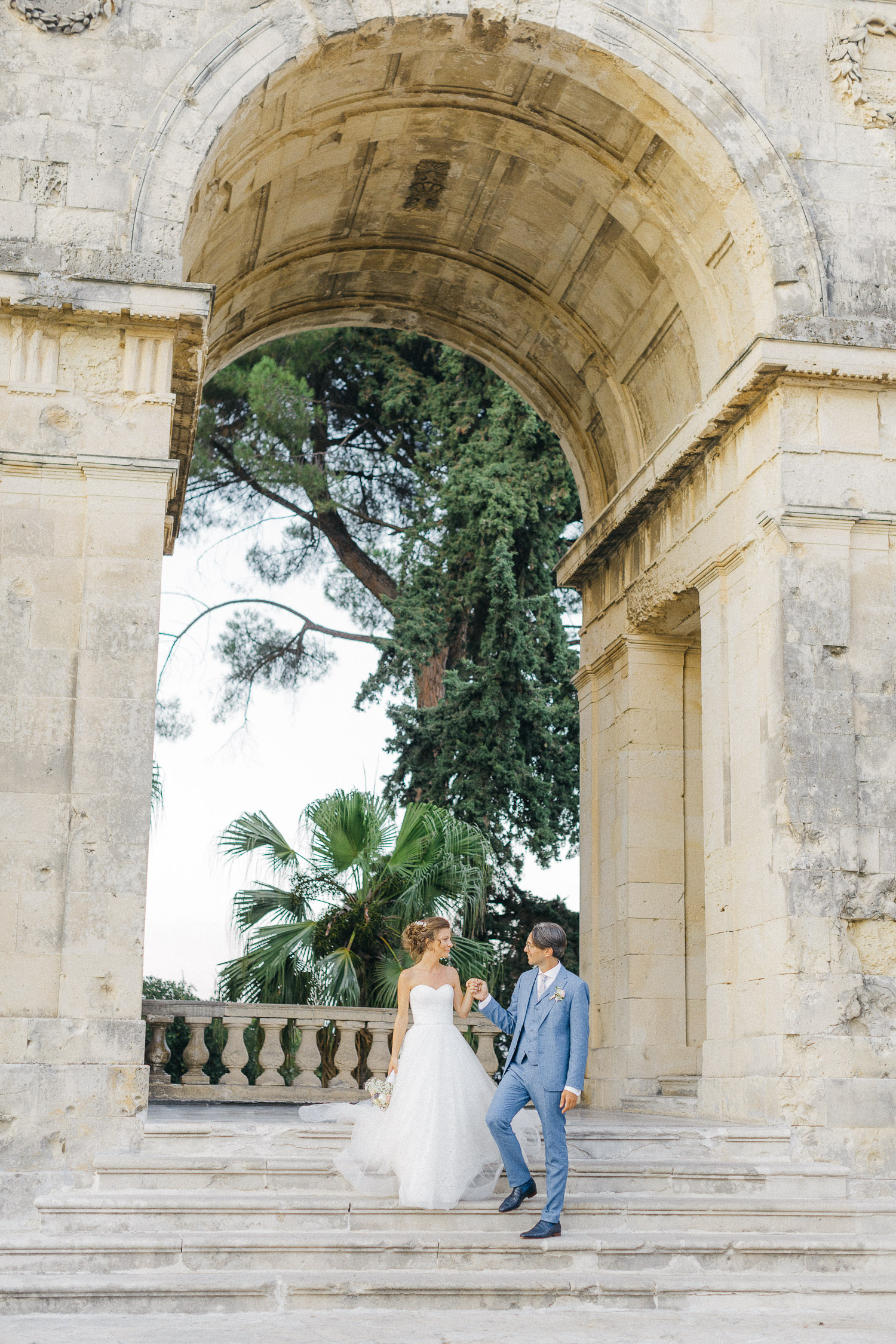 Newlyweds having some post ceremony portraits while an Old World micro wedding in Corfu Island