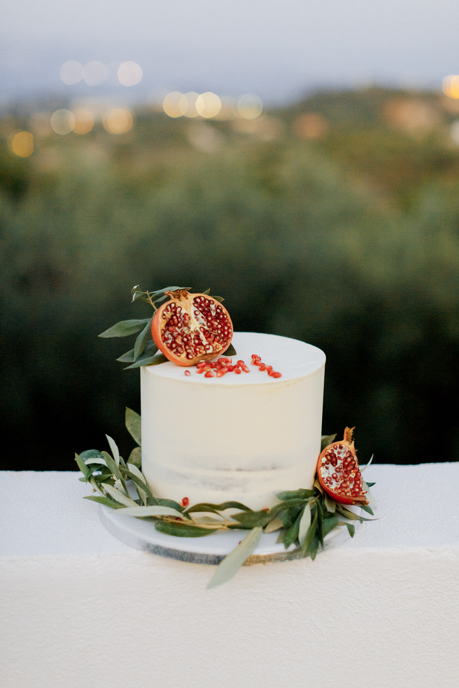 Pomegranate wedding naked cake with olive tree details at Old World micro wedding in Corfu Island