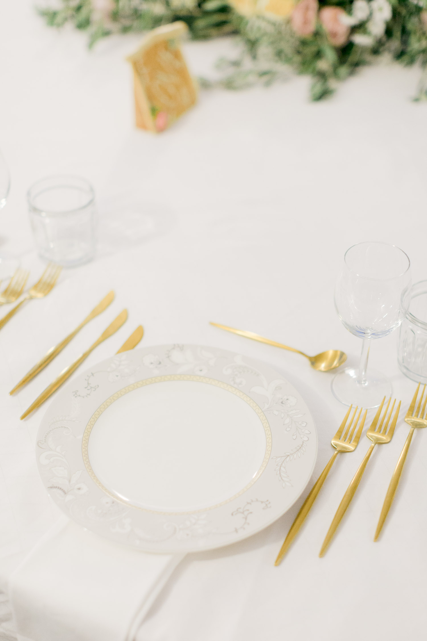 Wedding table set up with gold cutlery while Old World micro wedding in Corfu Island
