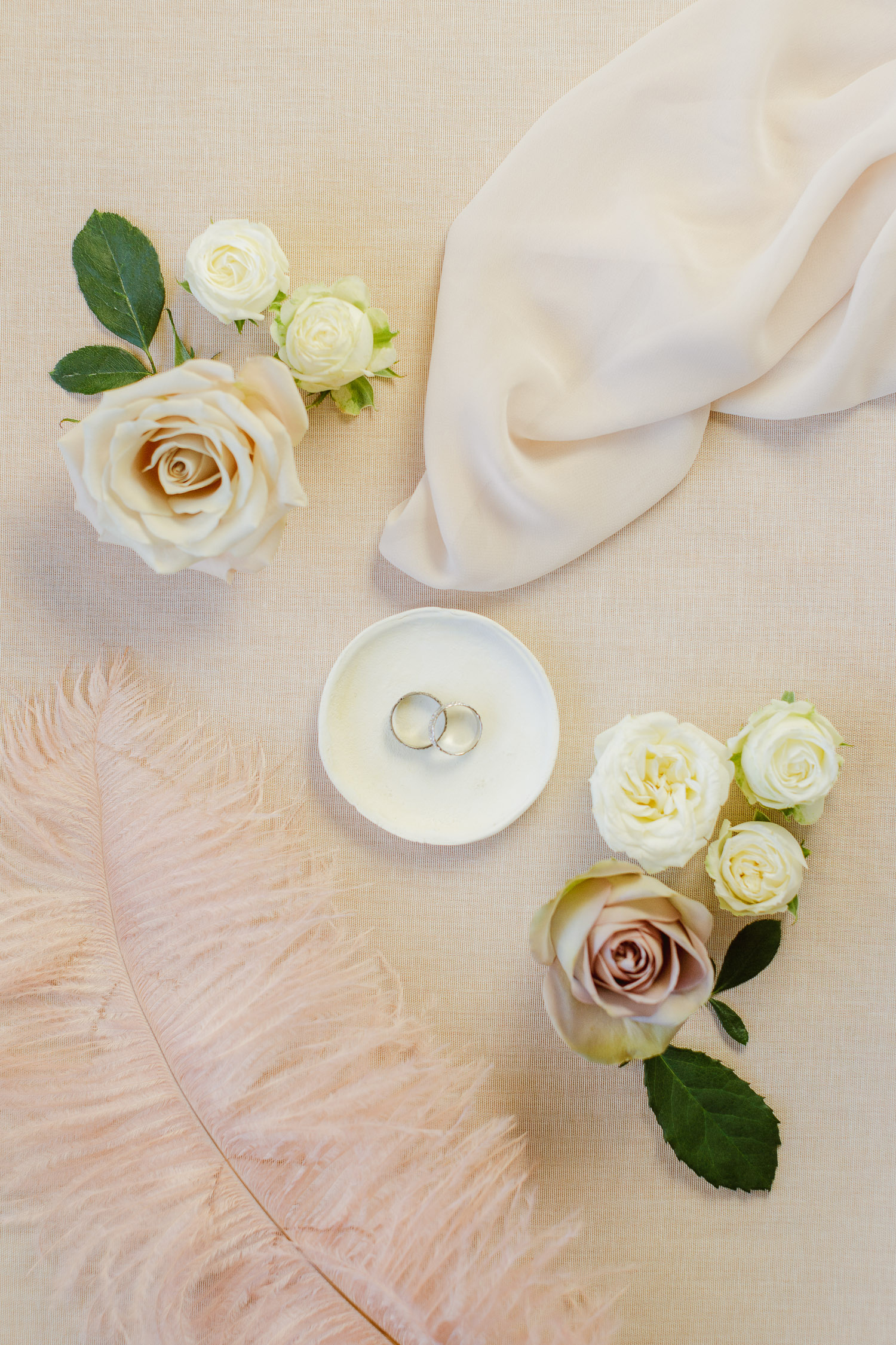 Wedding rings flat-lay photography styling perfectly with beautiful white roses